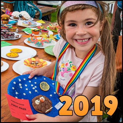 Photo of little girl holding homemade biscuit overlaid with the word '2019'